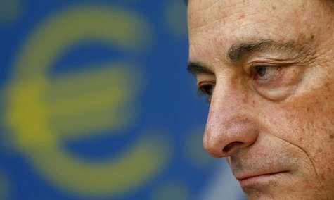 Mario Draghi, President of the European Central Bank (ECB), listens to reporter's questions during his monthly news conference in Frankfurt,