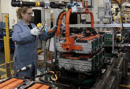 A Ford Motor production worker assembles batteries for Ford electric and hybrid vehicles at the Ford Rawsonville Assembly Plant in Ypsilanti