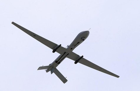 A U.S. Air Force MQ-1 Predator, unmanned aerial vehicle, armed with AGM-114 Hellfire missiles, performs a low altitude pass during the Aviat