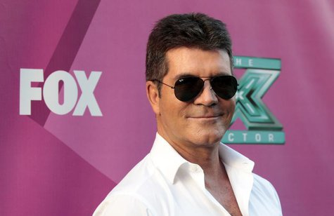 "Judge Simon Cowell poses at the season two premiere of the television series ""The X Factor"" at Grauman's Chinese theatre in Hollywood, Calif"