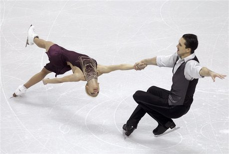 Tatiana Volosozhar (L) and Maxim Trankov of Russia perform their pairs short program at the ISU World Figure Skating Championships in London