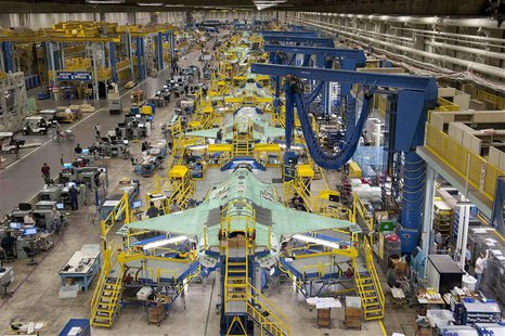 Workers are seen on the moving line and forward fuselage assembly areas for the F-35 Joint Strike Fighter at Lockheed Martin Corp's factory