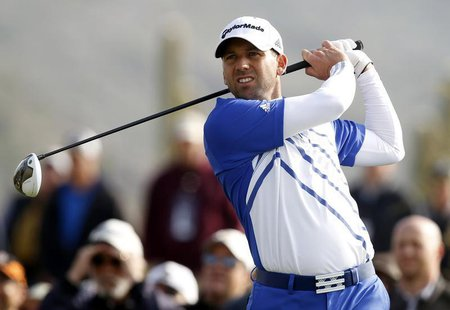 Sergio Garcia of Spain watches his tee shot on the first hole during the second round of the WGC-Accenture Match Play Championship golf tour