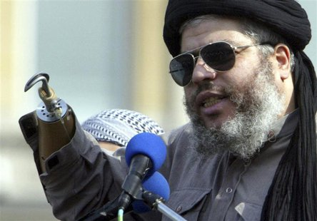 Muslim cleric, Abu Hamza al-Masri, is seen addressing the sixth annual rally for Islam in Trafalgar Square, London in this August 25, 2002 f