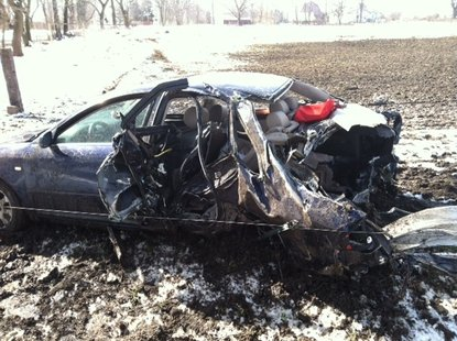 it was a violent wreck that totaled the car.