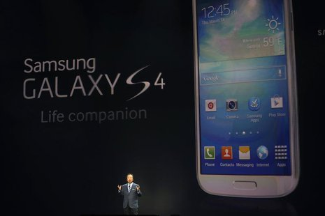 JK Shin, President and head of IT and Mobile Communication Division, introduces Samsung Electronics Co's latest Galaxy S4 phone during its l