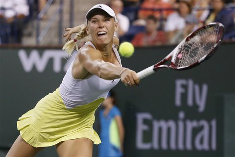 Caroline Wozniacki of Denmark returns a shot against Angelique Kerber of Germany during their women's singles semifinal match at the BNP Par
