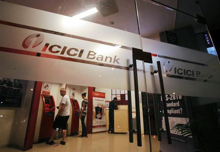 Customers use ATM machines at an ICICI Bank branch in Mumbai January 30, 2013. REUTERS/Vivek Prakash