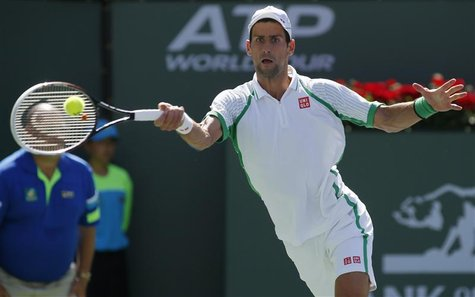 Novak Djokovic of Serbia returns a shot against Jo-Wilfried Tsonga of France during their men's singles quarterfinal match at the BNP Pariba