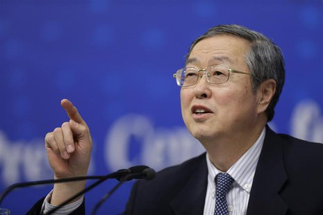 China's central bank governor Zhou Xiaochuan answers a question at a news conference during China's annual session of parliament, in Beijing