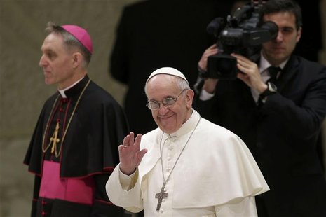Pope Francis I arrives in the Paul VI hall during an audience for members of the media, at the Vatican March 16, 2013. REUTERS/Max Rossi
