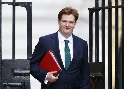 Britain's Chief Secretary to the Treasury Danny Alexander leaves after attending a Cabinet meeting at Number 10 Downing Street in London Mar