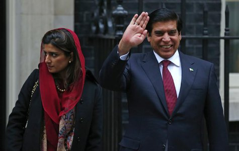 Pakistan's Prime Minister Raja Pervez Ashraf (R), waves as he leaves with Foreign Minister Hina Rabbani Khar, after their meeting with Brita