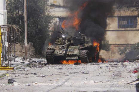 A burning tank is seen in Daraa March 9, 2013. Picture taken March 9, 2013. REUTERS/Ali Abu-Salah/Shaam News Network/Handout