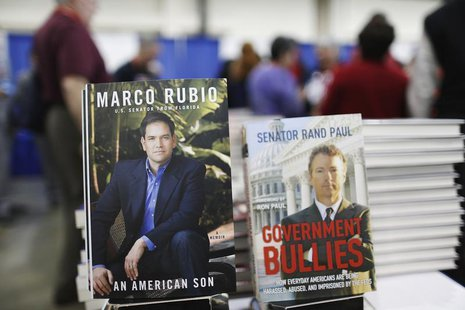 Books by U.S. Senators Marco Rubio and Rand Paul share a table display at the Conservative Political Action Conference (CPAC) in National Ha