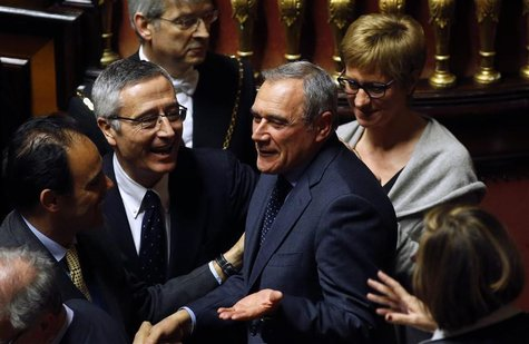 Piero Grasso (C) is congratulated after the vote electing him as the new Senate president at the Senate in Rome March 16, 2013. REUTERS/Remo