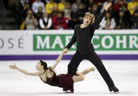 Meryl Davis and Charlie White of the U.S. perform their ice dance free dance at the ISU World Figure Skating Championships in London, Ontari