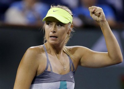 Maria Sharapova of Russia celebrates defeating compatriot Maria Kirilenko in their women's singles semifinal match at the BNP Paribas Open W