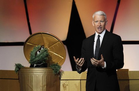 Television host Anderson Cooper and Oscar the Grouch, a character from Sesame Street, open the 39th Daytime Emmy Awards in Beverly Hills, Ca