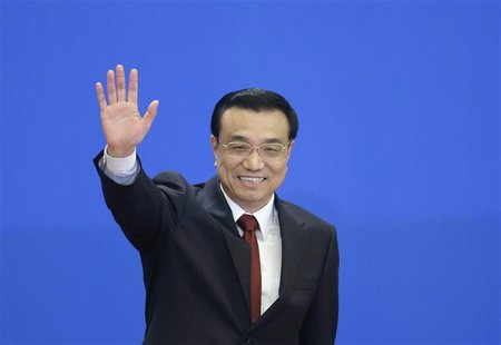 China's newly elected Premier Li Keqiang waves as he leaves a news conference after the closing session of the National People's Congress (N