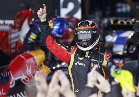 Lotus Formula One driver Kimi Raikkonen of Finland celebrates winning the Australian F1 Grand Prix at the Albert Park circuit in Melbourne M
