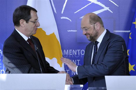 Cyprus President Nicos Anastasiades (L) and European President Martin Schulz give statements to the media at the European Parliament in Brus