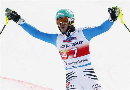 Felix Neureuther of Germany celebrates winning the season's last men's Slalom race at the Alpine Skiing World Cup finals in Lenzerheide Marc