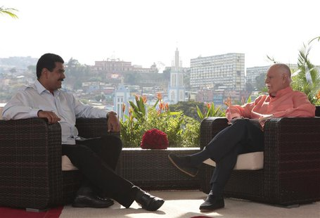 Venezuela's acting President Nicolas Maduro (L) speaks during an interview in Caracas, March 16, 2013, in this handout photo provided by the
