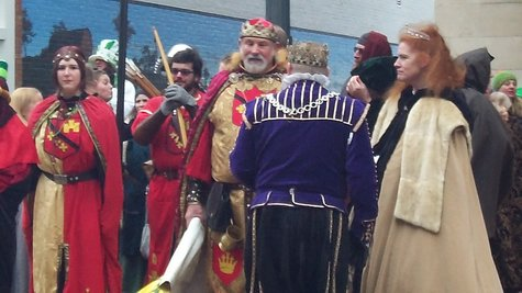 Renaissance Fair King and his court wait their turn to join the parade.