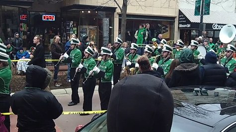 The Hackett High School Band decked out in green and playing Irish tunes.
