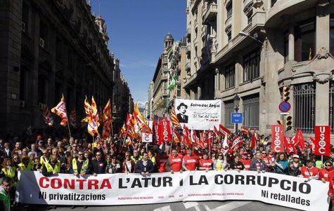 People hold banners and placards as they march during a protest against government austerity measures in Barcelona March 10, 2013. REUTERS/A