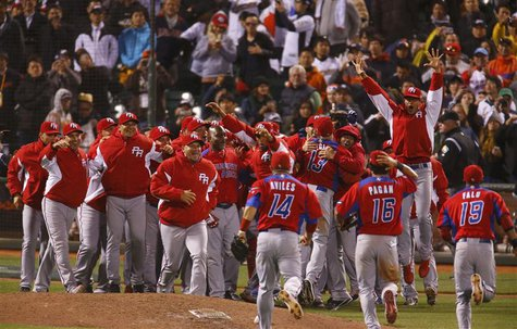 Puerto Rico players celebrate after defeating Japan in their semi-final World Baseball Classic game in San Francisco, California, March 17,