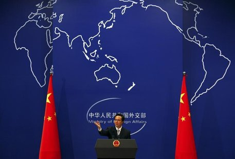 China's Foreign Ministry spokesman Hong Lei asks journalists for questions during a news conference in Beijing July 7, 2011. REUTERS/David G
