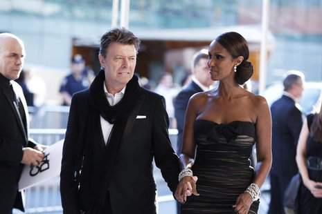 Singer David Bowie arrives with his wife Iman to attend the Council of Fashion Designers of America (CFDA) fashion awards in New York June 7