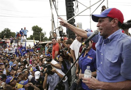Venezuela's opposition leader and presidential candidate Henrique Capriles (R) speaks to supporters during a rally in Maracaibo March 17, 20