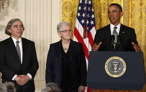 U.S. President Barack Obama stands next to two new nominees for senior positions in his Administration while in the East Room of the White H