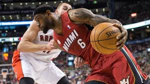 LeBron James drives on as the Heat sail to 22nd straight win.  The Miami Heat Won Against the Toronto Raptors 108-91.
