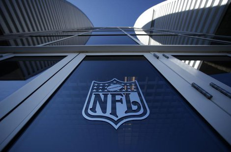 The NFL logo appears on an entrance door to the football stadium at Super Bowl XLII in Glendale, Arizona February 2, 2008. REUTERS/Mike Blak