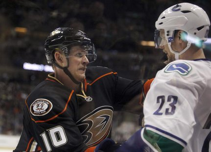 Anaheim Ducks right wing Corey Perry (10) attempts to incite Vancouver Canucks defenseman Alexander Edler (23) of Sweden into a fight, but P