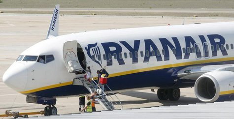 Passengers board a Ryanair plane parked at Girona airport, September 20, 2012. REUTERS/Albert Gea