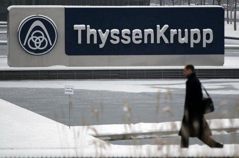 A man walks past a logo of Germany's industrial conglomerate ThyssenKrupp AGat their headquarters in Essen January 16, 2013. REUTERS/Ina Fas