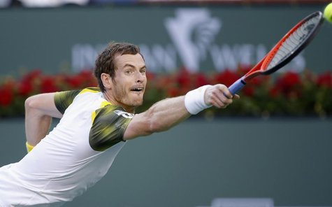 Andy Murray of Britain reaches but misses a serve by Juan Martin Del Potro of Argentina during their men's singles quarterfinal match at the