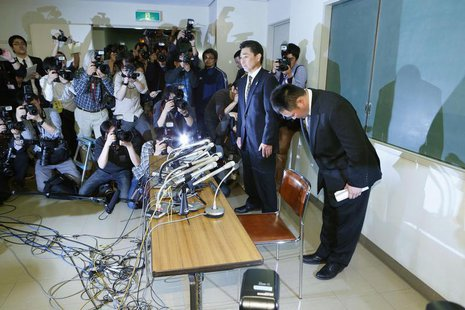 Japanese women's Judo coach Ryuji Sonoda (R) bows at a news conference in Tokyo, in this photo taken by Kyodo January 31, 2013. REUTERS/Kyod