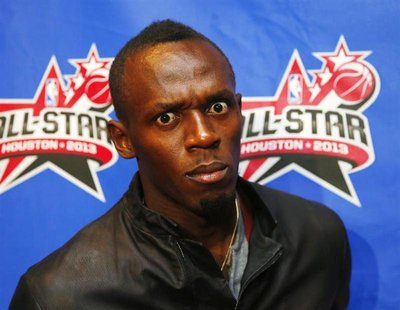 Olympic gold medal sprinter Usain Bolt arrives for the 2013 NBA All-Star basketball game in Houston, Texas, February 17, 2013. REUTERS/Jeff