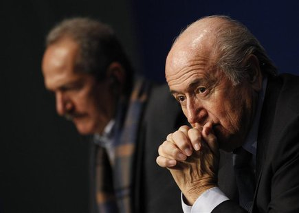 FIFA President Sepp Blatter (R) and Brazil's Minister of Sports Aldo Rebelo attend a news conference at the Home of FIFA in Zurich, March 19
