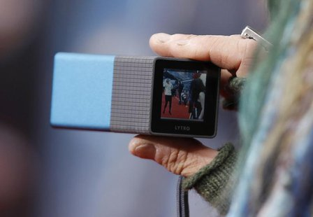 "A guest uses a Lytro light field camera on the red carpet at the world premiere of the film ""Marvel's The Avengers"" in Hollywood, California"