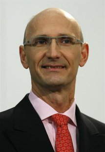 File photo of Timotheus Hoettges, Board member responsible for T-Com attends a news conference in Bonn December 6, 2006.REUTERS/Ina Fassbend