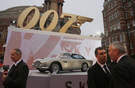 "An Aston Martin car is displayed near television crews before guests arrive for the royal world premiere of the new 007 film ""Skyfall"" at th"