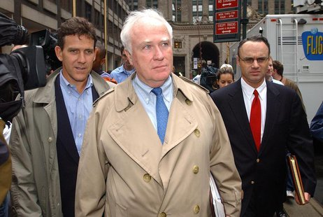 Major League Baseball's Tim Brosnan, Robert DuPuy and Rob Manfred (L-R) leave 245 Park Avenue en route to the Major League Baseball Players