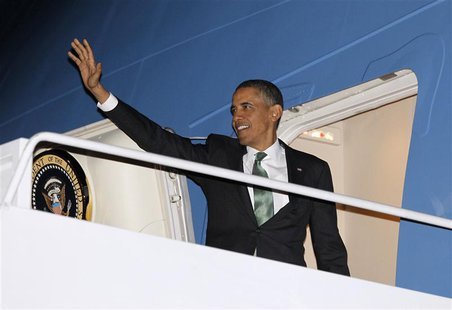 U.S. President Barack Obama waves as he steps aboard Air Force One at Andrews Air Force Base near Washington, March 19, 2013. Obama is trave